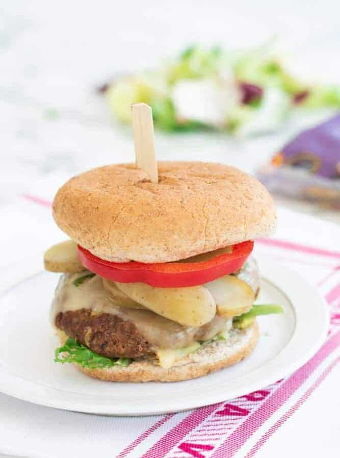 made up slimming world cheese burger with wooden spike on white plate