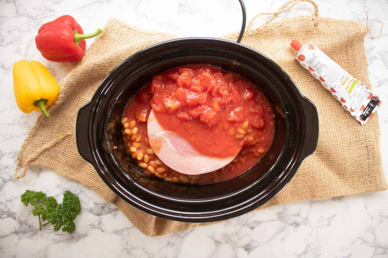 beans, tomatoes and gammon for campfire stew in the slow cooker