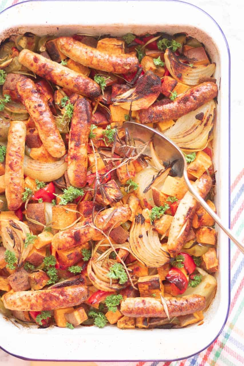 low syn heck chicken sausages, sweet potato, onions and peppers baked in a tray