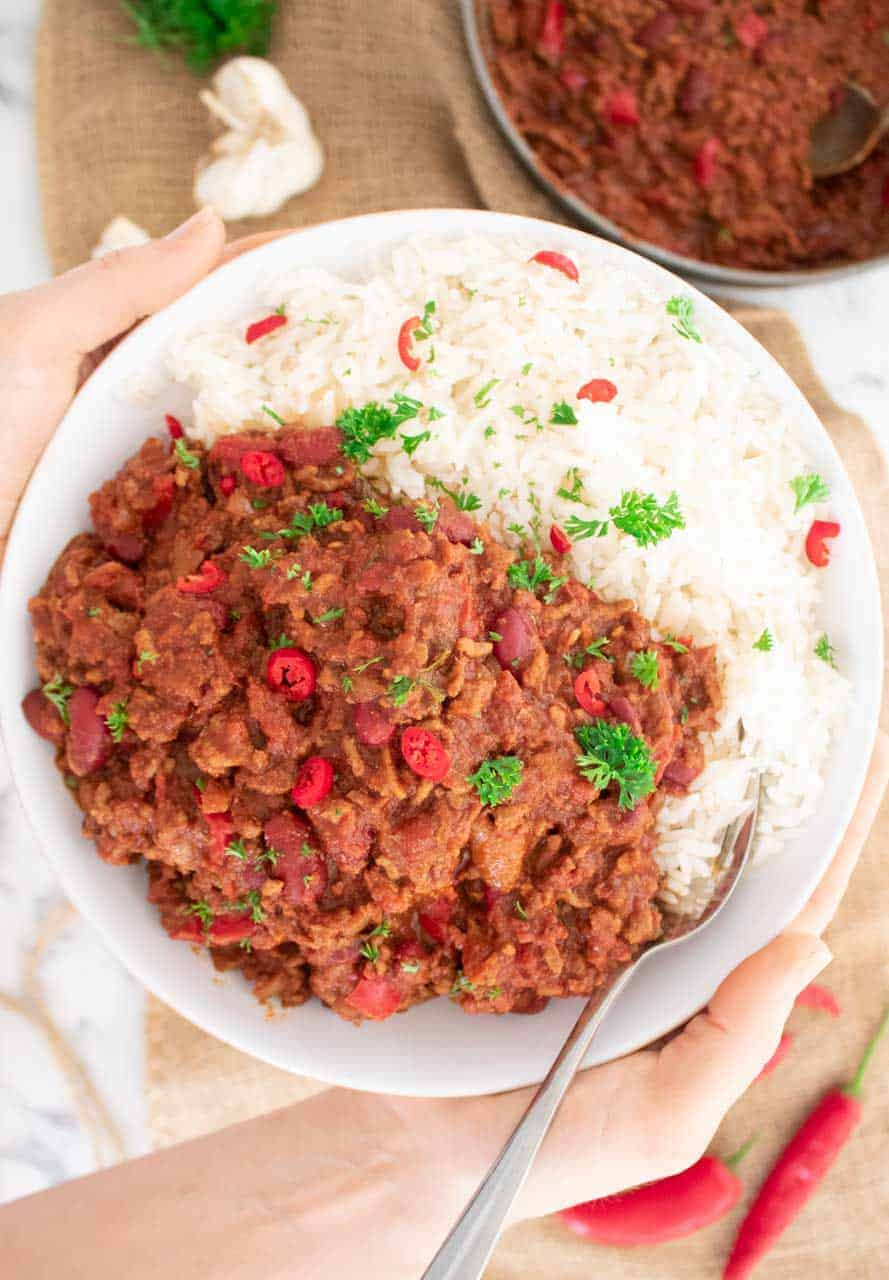 close up of chilli con carne in a bowl with rice